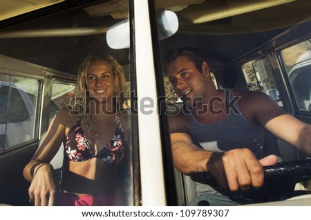 Young couple sitting in a car - stock photo