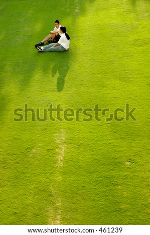 Young couple sitting on grass