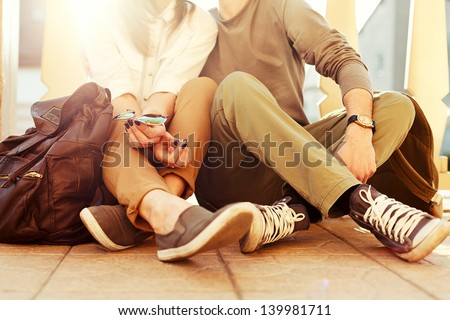 young couple sitting on the...
