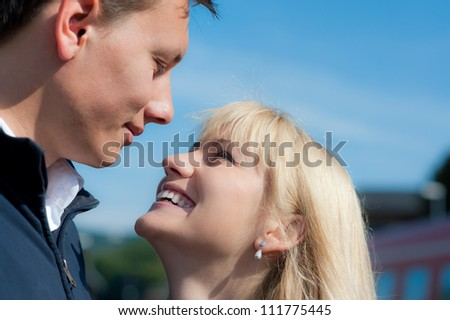 Young couple smiles at each other