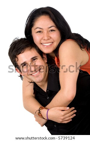 young couple smiling and standing next to each other - isolated over a white background
