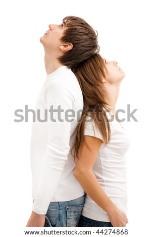 Young couple standing, looking up and dreaming - stock photo