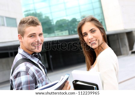 Young couple standing outside university campus