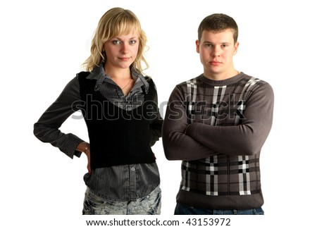 young couple standing together, white background