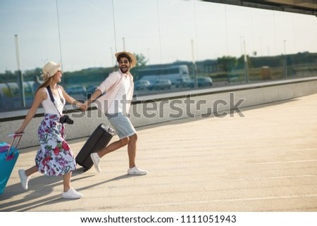 Young couple staring to arrive on a flight