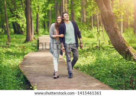 Young couple strolling in the park ストックフォト ©