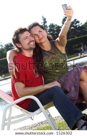 Young couple taking a photo with a mobile phone.