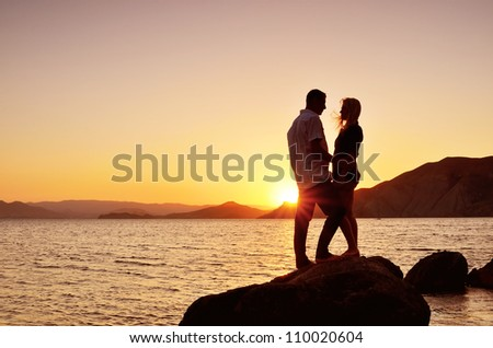 Young couple talking to the sea at night