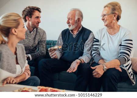 Young couple talking with their parents #1015146229