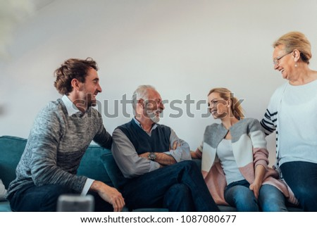 Young couple talking with their parents #1087080677