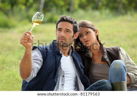 young couple tasting their wine production