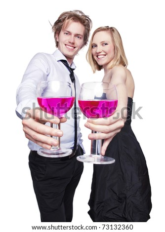 Young couple toasting with pink drink. Selective Focus. Studio photo, isolated. - stock photo