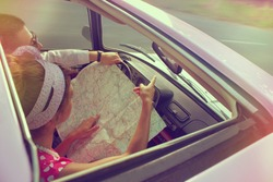 Young couple traveling by car on vacation