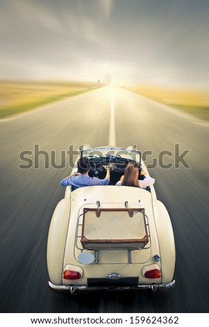 young couple traveling on a...