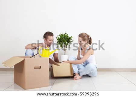 Young couple unpacked on the floor