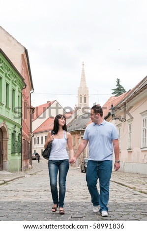 Young couple walking in old town of Bratislava (capital of Slovakia) - stock photo