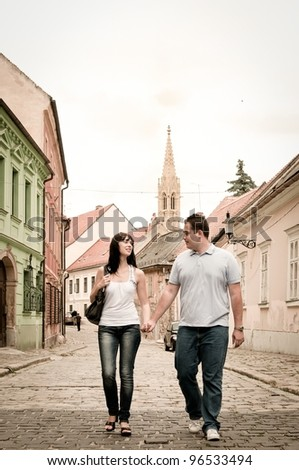 Young couple walking in old town of Bratislava (capital of Slovakia)