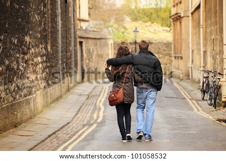 young couple walking in the old city