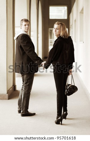 Young couple walking on a street - stock photo