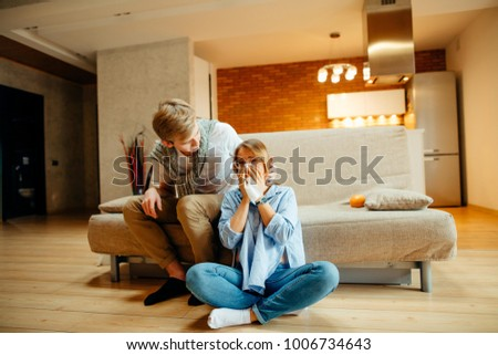 Young couple watching sad movie, woman cry #1006734643