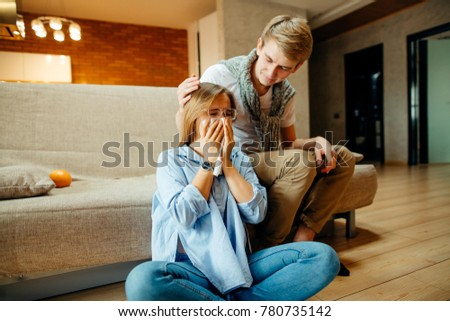 Young couple watching sad movie, woman cry #780735142