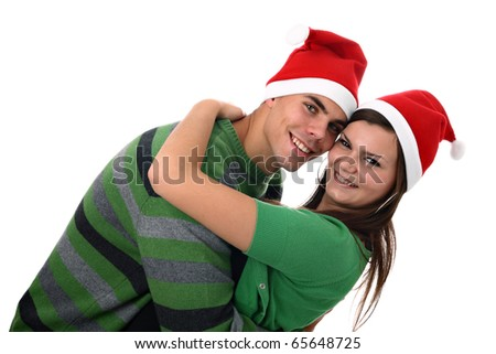 Young couple wearing Santa's hats hugging each other isolated on white