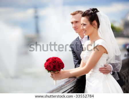 Young couple wedding. Looking to the river.