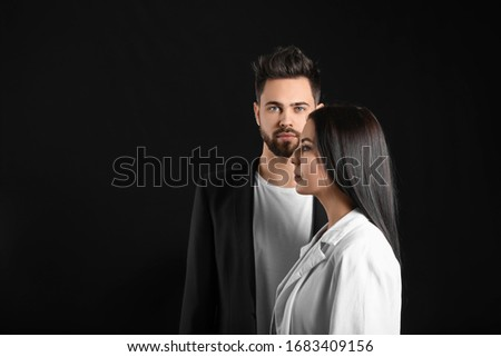 Young couple with beautiful healthy hair on dark background Сток-фото ©