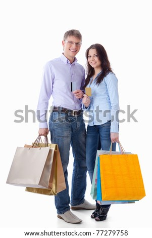 Young couple with credit cards and shopping on a white background