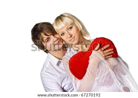young couple with red heart. isolated on white