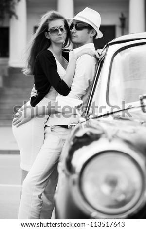 Young couple with retro car