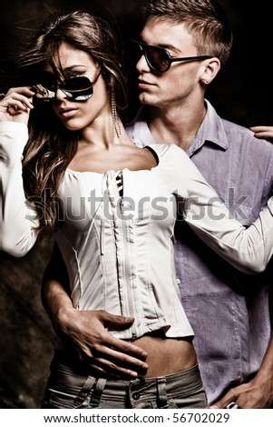 young couple with sunglasses, studio shot