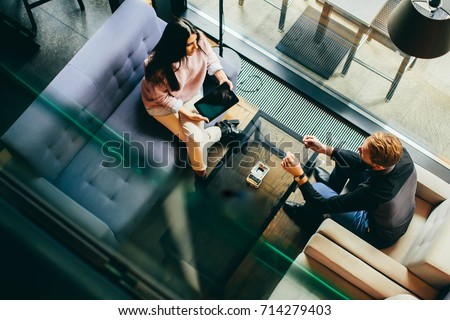 Young couple with tablet sitting in the cafe Stock foto ©