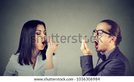 Young couple woman and man checking their breath with hand gesture  #1036306984