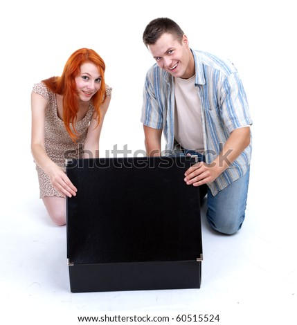 young couple, woman and man, with big black box