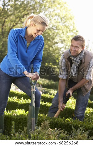 Young couple working in garden