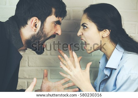 young couple yelling at each...