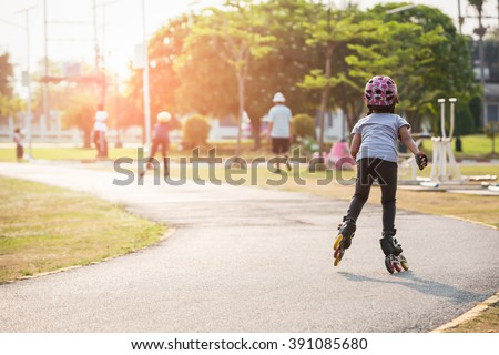 Young couples roller skates outdoor in park. - Shutterstock ID 391085680