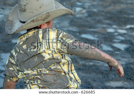 Young cowboy in the mud