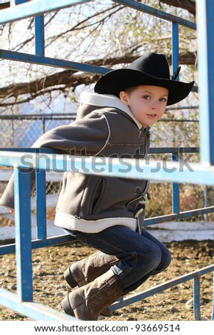 Young cowboy wearing a hat and fleece jacket