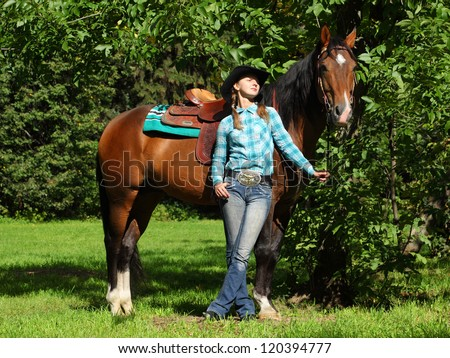 Young cowgirl with horse outdoor