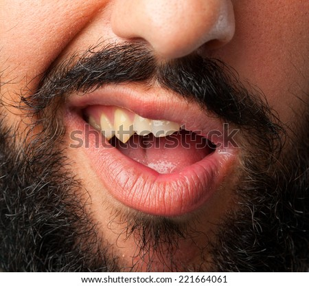 young crazy bearded man mouth
