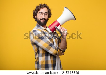 6136a10eec68e young crazy mad man fool pose with a megaphone. announcement concept   1215918646