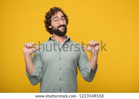young crazy man smiling proudly and confidently with arms hands on hips in akimbo pose, happy and sure of success, giving an