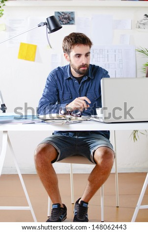 Young creative designer man working at office. / Creative man.