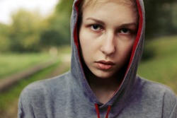 Young criminal said teenager posing outdoor on the street.