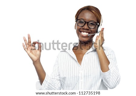 Young customer service agent showing okay gesture to camera