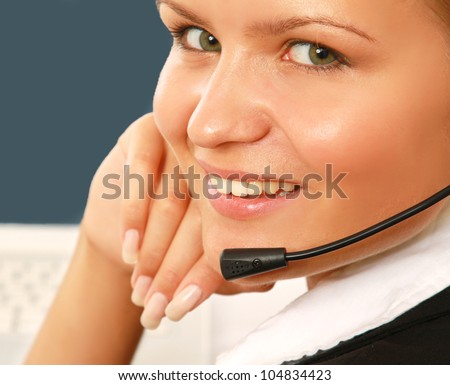 Young customer service operator with laptop