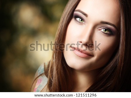 young cute beautiful woman portrait with long hair looking at camera