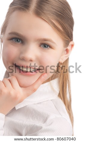 young cute caucasian blond girl wearing teeth braces standing in white shirt isolated over white background smiling
